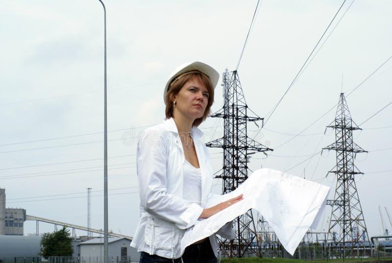 architekta rysunków inżyniera kapeluszowa zbawcza kobieta obrazy royalty free