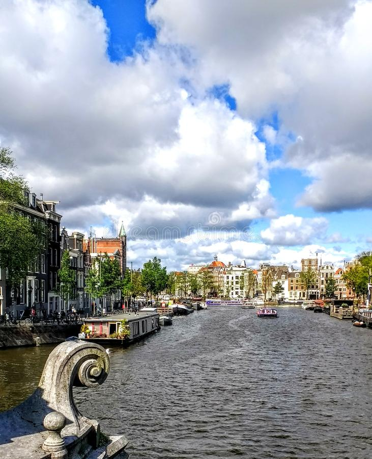 Amsterdam canal cloud. Architektur canal travel river sky cloudy royalty free stock images
