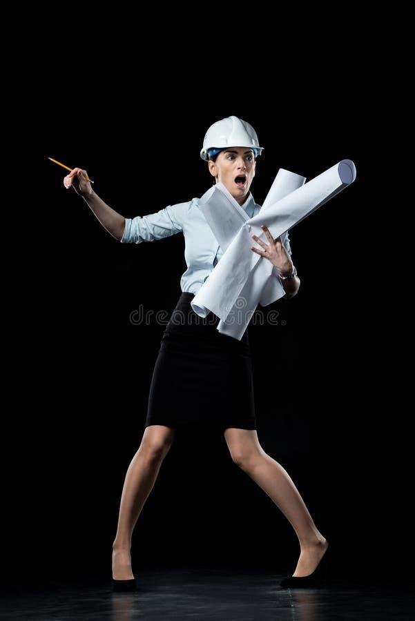 Architetto femminile in casco immagini stock