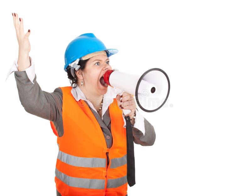 Architetto o assistente tecnico femminile grasso con il megafono fotografia stock