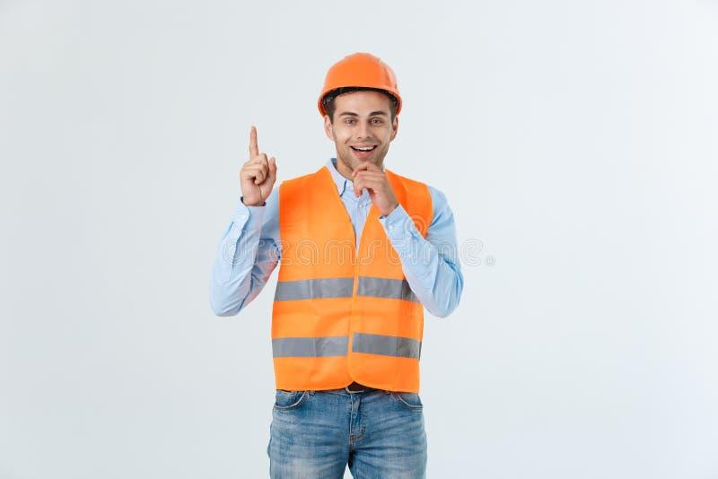 Architetto o ingegnere immaginario che cerca e che pensa ai nuovi progetti Elmetto protettivo giallo d'uso e maglia riflettente fotografie stock libere da diritti
