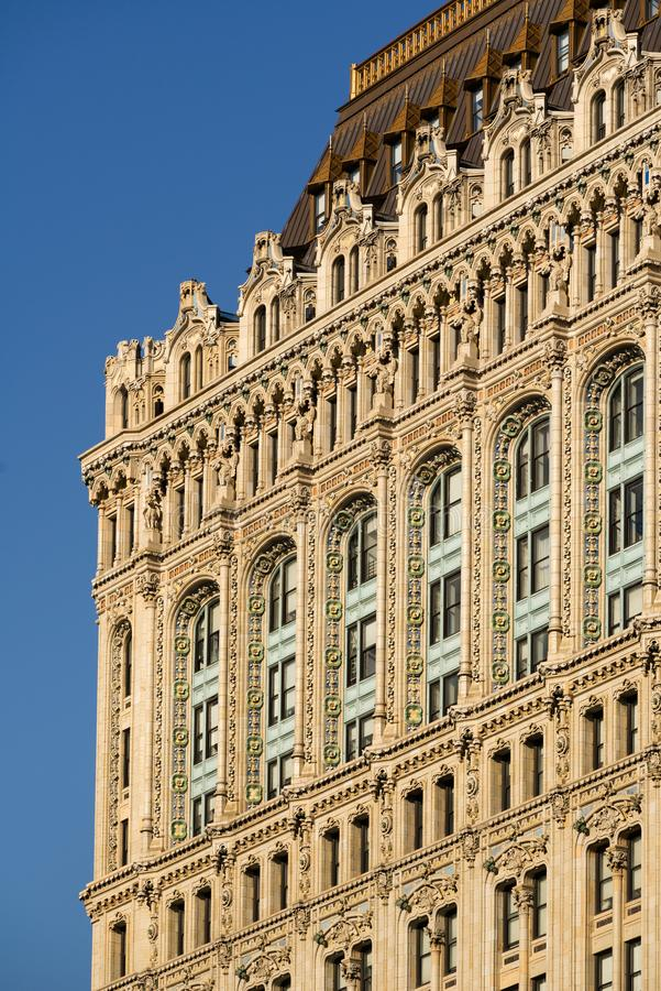 Architural detail of the 90 West Street building facade with intricate terracotta ornaments. Lower Manhattan, New York City. New York City, NY, USA - Avril 18 stock photos