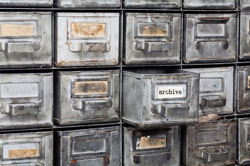 Archive old style interior. Closed metallic storage, filing cabinet. aged silver metal boxes with index cards. library royalty free stock image