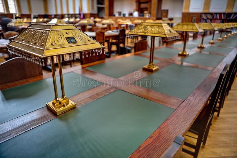 Archive Reading Room. Big and old reading room shot with high depth of field DOF. Focus on the front lamp royalty free stock photo