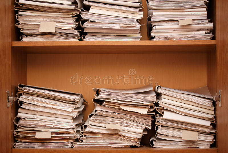 Archive. Wooden shelves with paper folders royalty free stock images