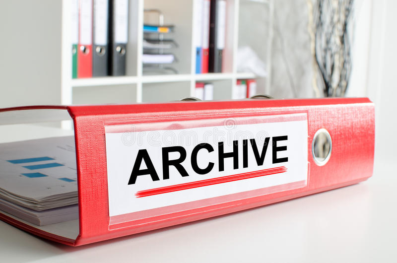 Archive wording on a binder. Archive wording on the back of a red binder royalty free stock photos