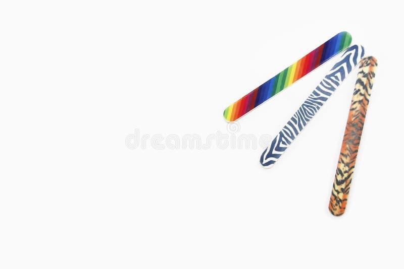 Archivi di unghia usati multicolori del manicure di pedicure su fondo isolato bianco immagine stock libera da diritti