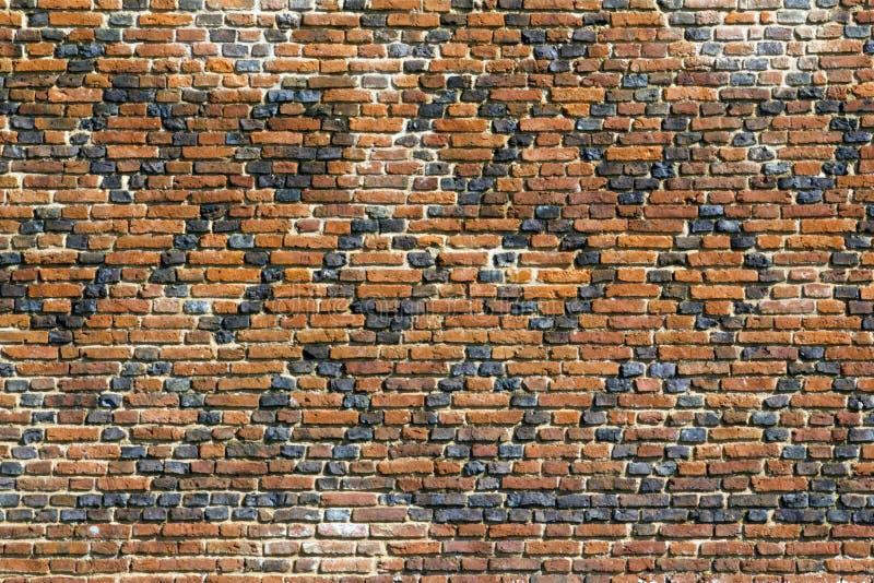 Archtecturetextuur - Oude gevormde bakstenen muur royalty-vrije stock afbeeldingen