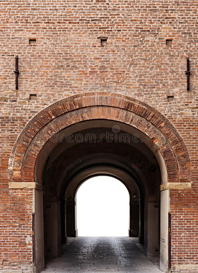 Archway in the ancient brick fortress wall royalty free stock photography