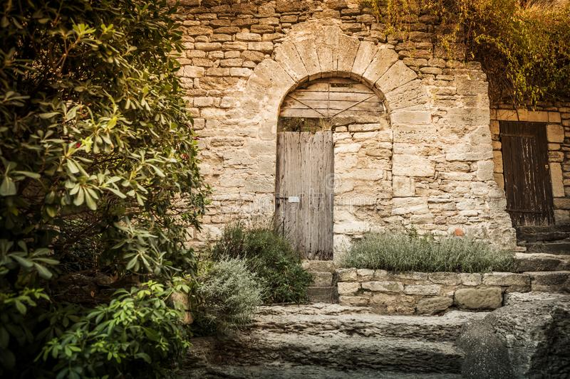 Archway gate and historic stone wall in the garden nook stock images