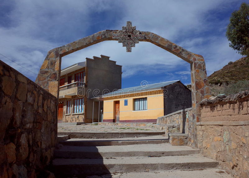 An archway with an Inca Cross in a traditional community on the Isla del Sol on Lake Titicaca. An archway showing an Inca Cross at the entrance to a traditional stock photo