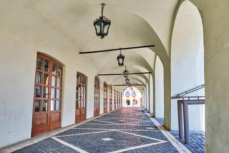Archway passage at Arts House - Butchers Guild Hall Casa Artelor in Sibiu, Romania, with a pattern of wooden doors royalty free stock images