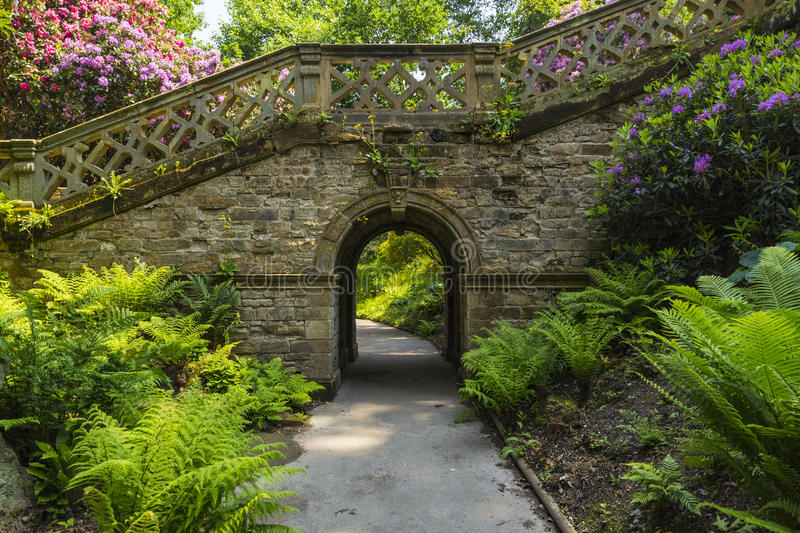 Archway and stairway in Hever Gardens royalty free stock photography