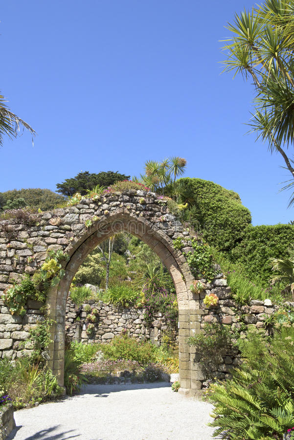 Archway with tropical plants, Scilly Islands royalty free stock image