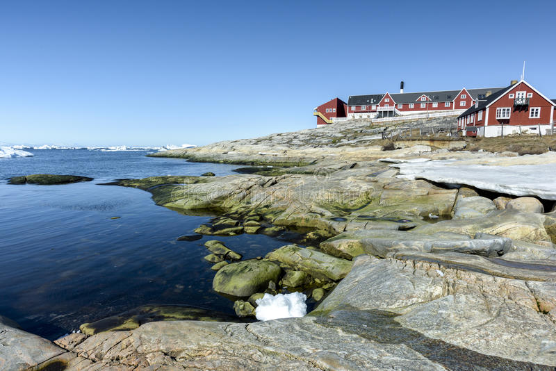 Arcic ocean with glaciers in Ilulissat city of the Greenland. May 2016. Traditional life in Ilulissat city of the Greenland. Glaciers are melting and climate royalty free stock image