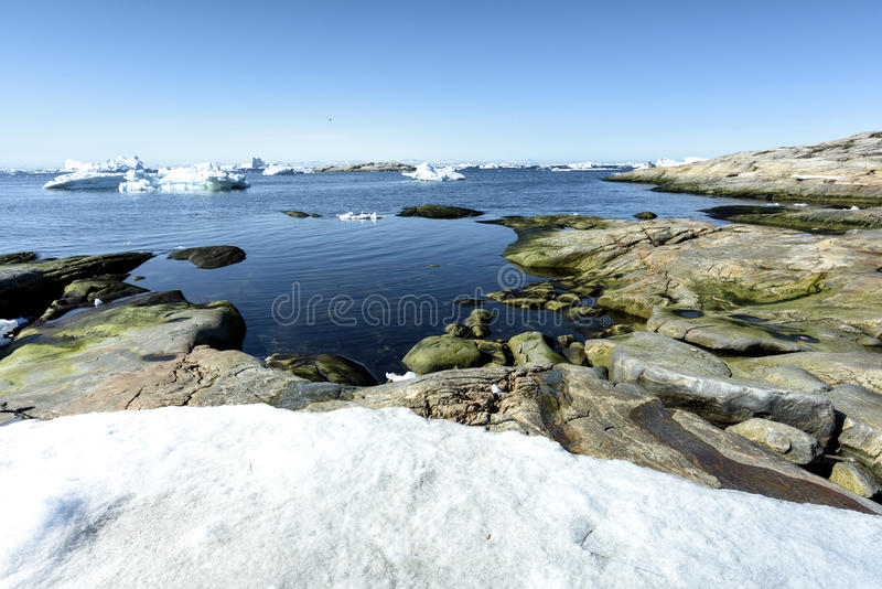 Arcic ocean with glaciers in Ilulissat city of the Greenland. May 2016. Traditional life in Ilulissat city of the Greenland. Glaciers are melting and climate royalty free stock images