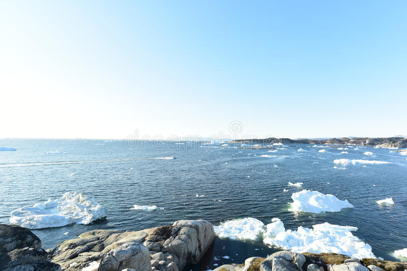Arcic ocean with glaciers in Ilulissat city of the Greenland. May 2016. Traditional life in Ilulissat city of the Greenland. Glaciers are melting and climate royalty free stock photos