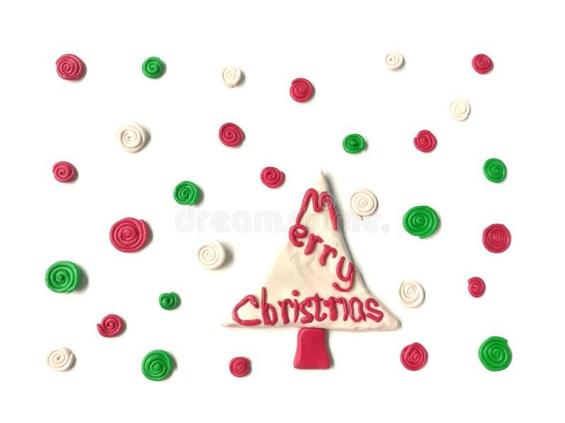 Arcilla hermosa del plasticine del árbol de navidad, pasta roja del texto de la decoración foto de archivo