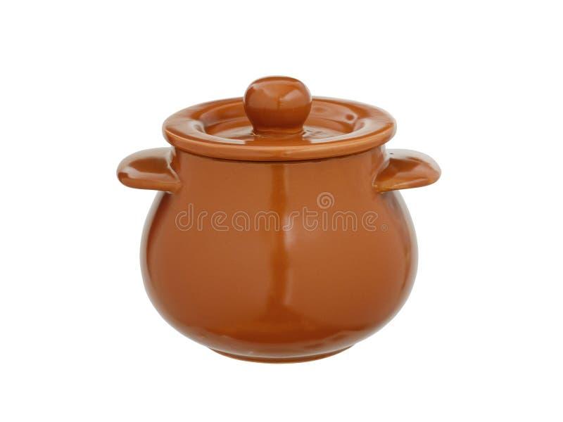 Arcilla, pote de cerámica con una cubierta aislada en un fondo blanco imagen de archivo libre de regalías