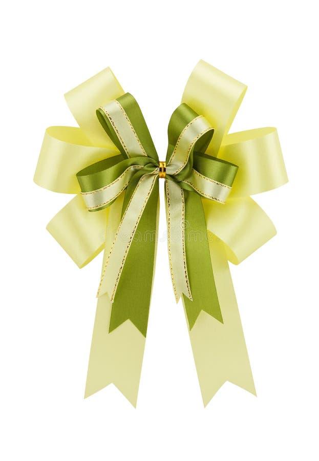 Arco amarillo del regalo de la cinta aislado en el fondo blanco fotografía de archivo libre de regalías