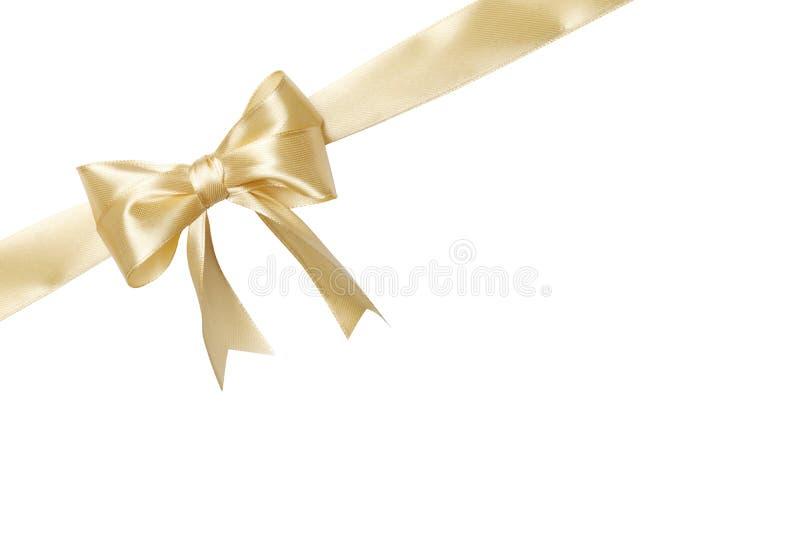 Arco beige de la cinta del color del oro aislado en el fondo blanco imagenes de archivo