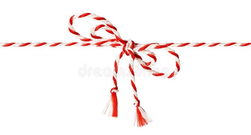 Arco bianco della corda rossa, bianco del nastro della cordicella fotografia stock
