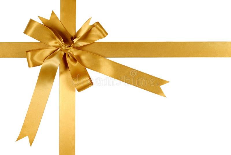 Arco de la cinta del regalo del oro amarillo aislado en el fondo blanco fotografía de archivo