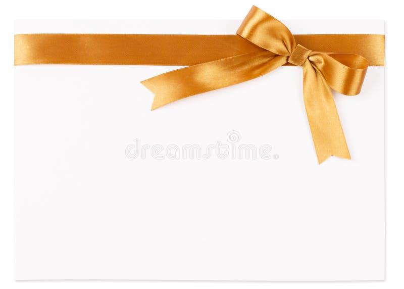 Arco del oro en una cinta de satén imagen de archivo