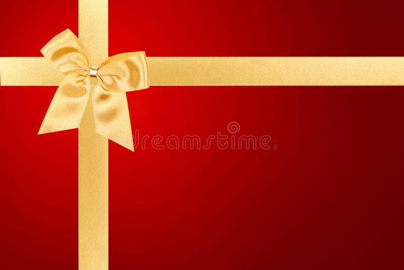 Arco dell'oro sulla scheda rossa fotografie stock