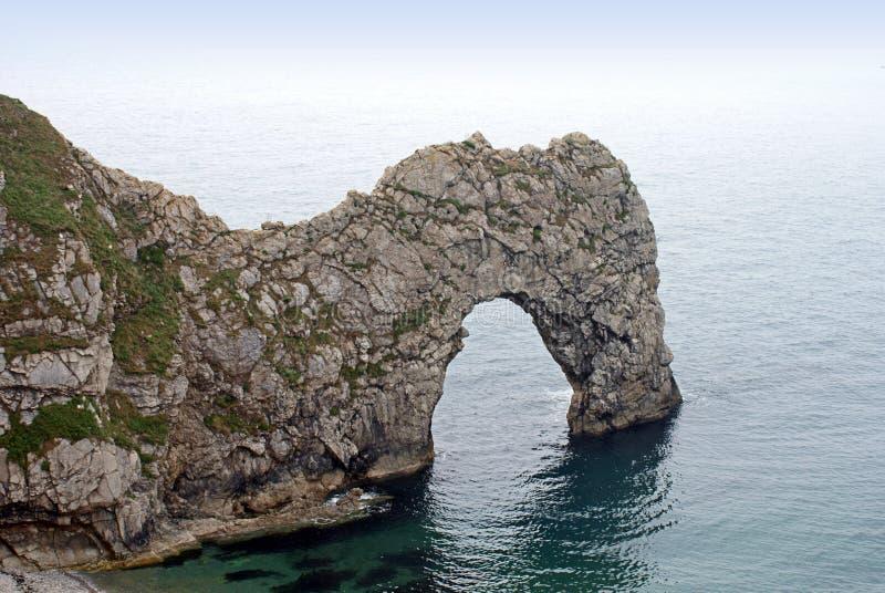Arco di pietra costiero naturale alla porta Dorset Inghilterra Regno Unito di Durdle immagini stock