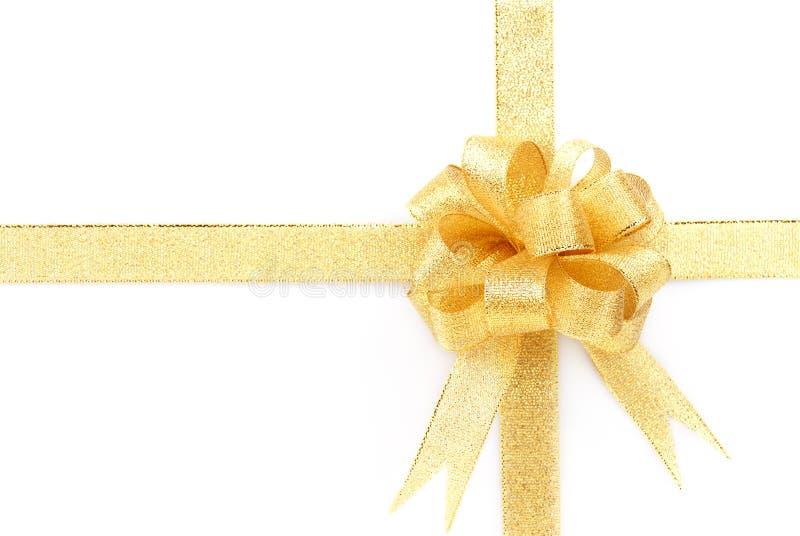 Arco dorato con il nastro dorato fotografia stock libera da diritti