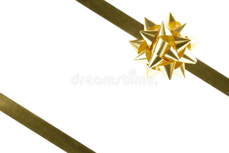 Arco e nastro dell'oro fotografia stock libera da diritti