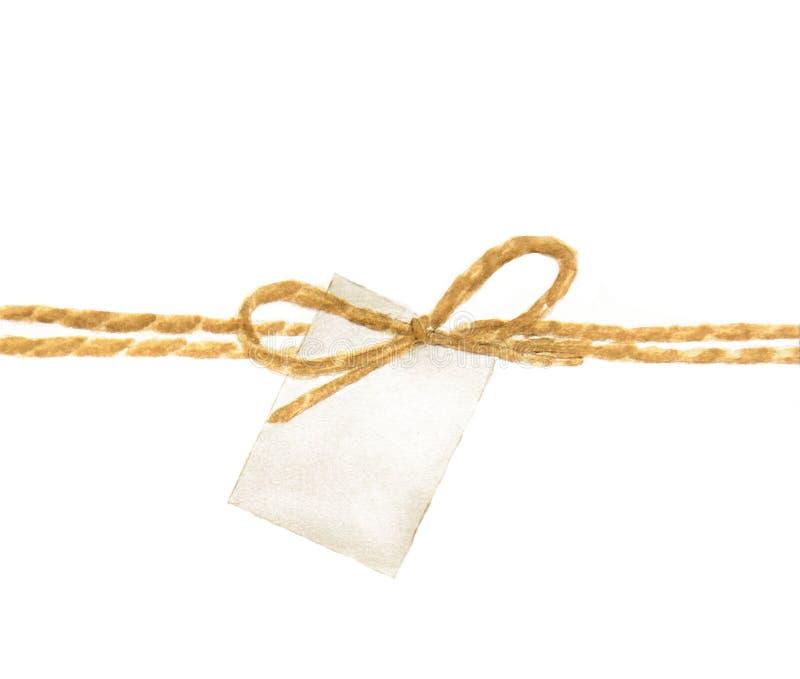 Arco ed etichetta della corda su fondo bianco fotografie stock libere da diritti