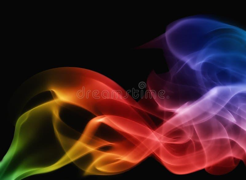 Arco iris del humo en fondo negro imágenes de archivo libres de regalías