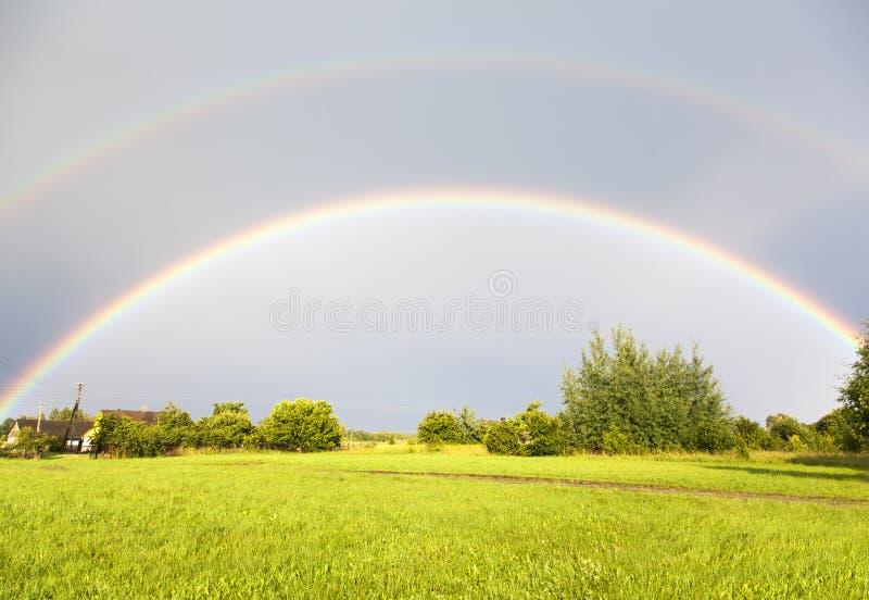 Arco iris doble fotos de archivo