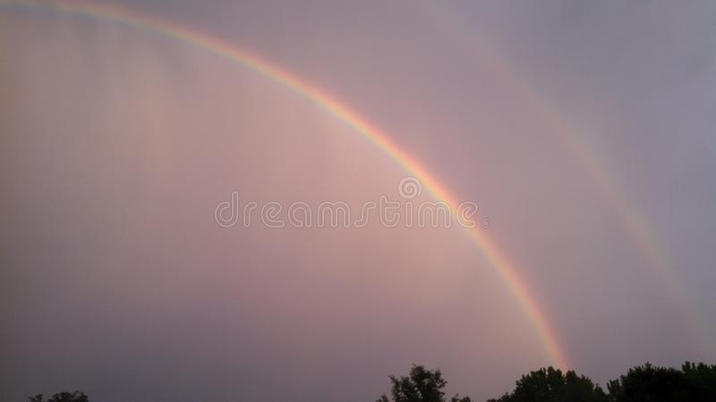 Arco iris doble foto de archivo