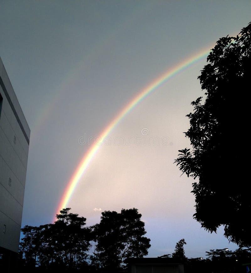 Arco iris en medio de la noche foto de archivo libre de regalías