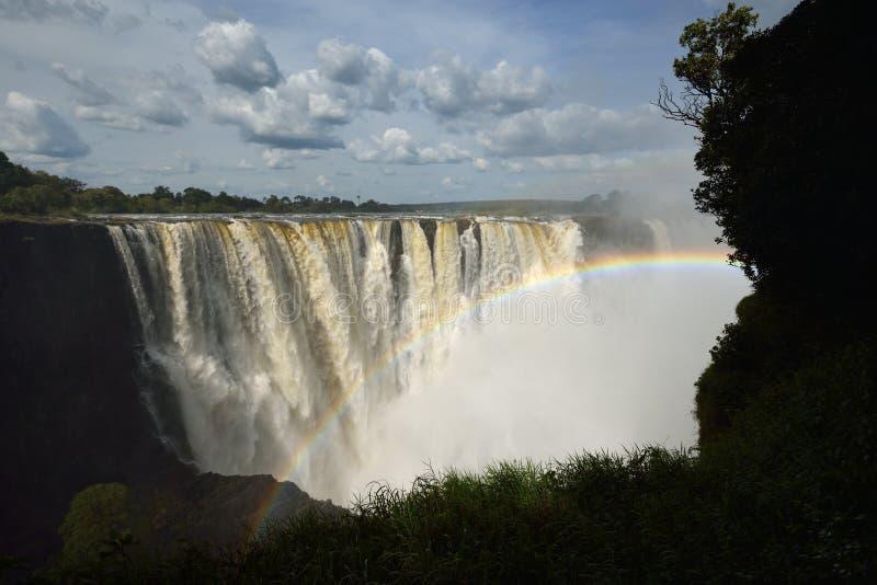 Arco iris sobre Victoria Falls fotos de archivo