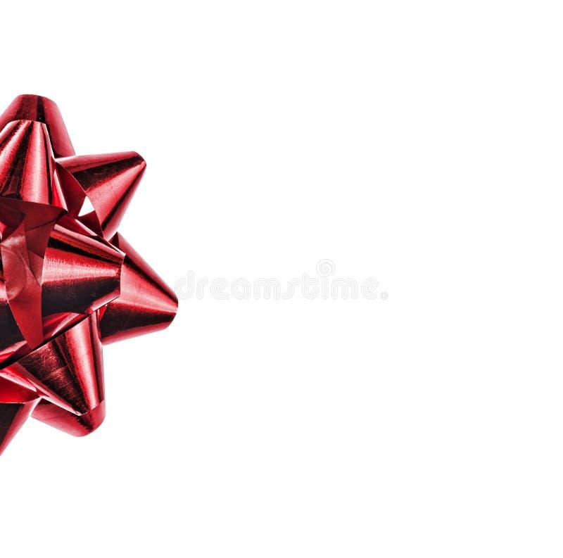 Arco rojo aislado en el fondo blanco Un símbolo del día de fiesta, un elemento de la decoración fotografía de archivo libre de regalías