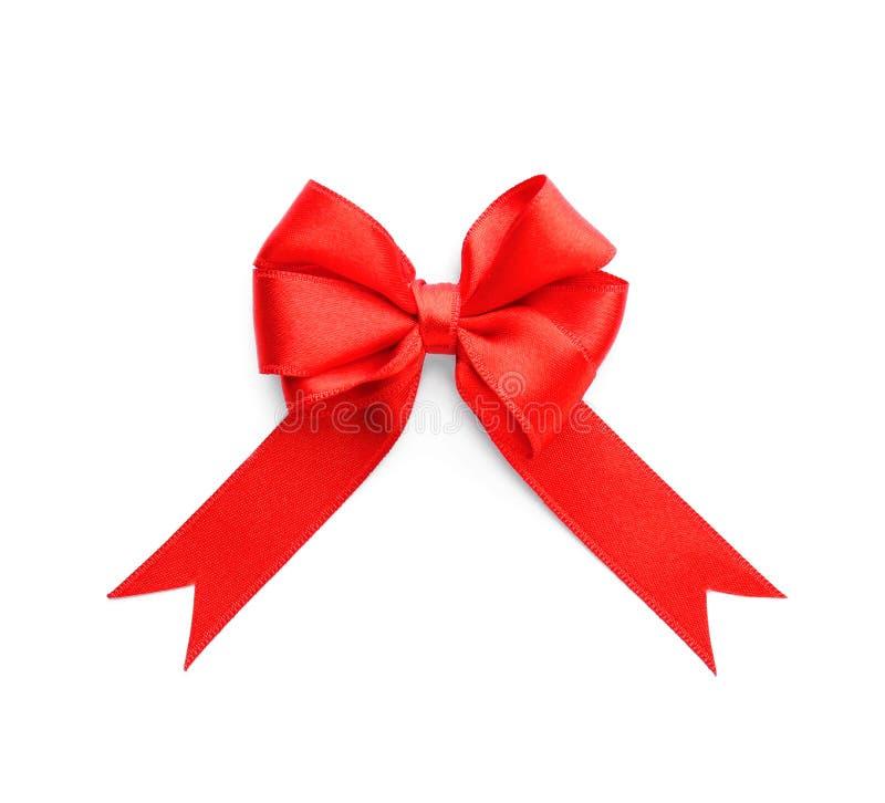Arco rojo de la cinta en el fondo blanco imagen de archivo libre de regalías