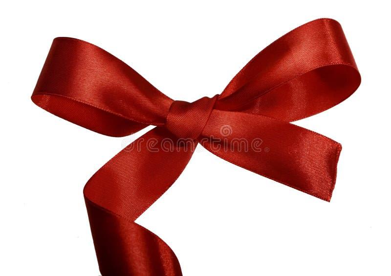 Arco rosso con le arricciature per un regalo fotografia stock