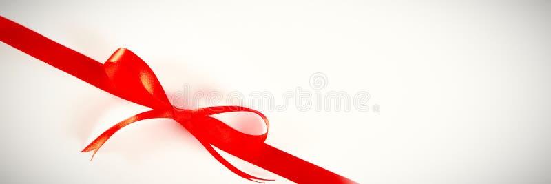 arco rosso del nastro del regalo, nodo fotografia stock