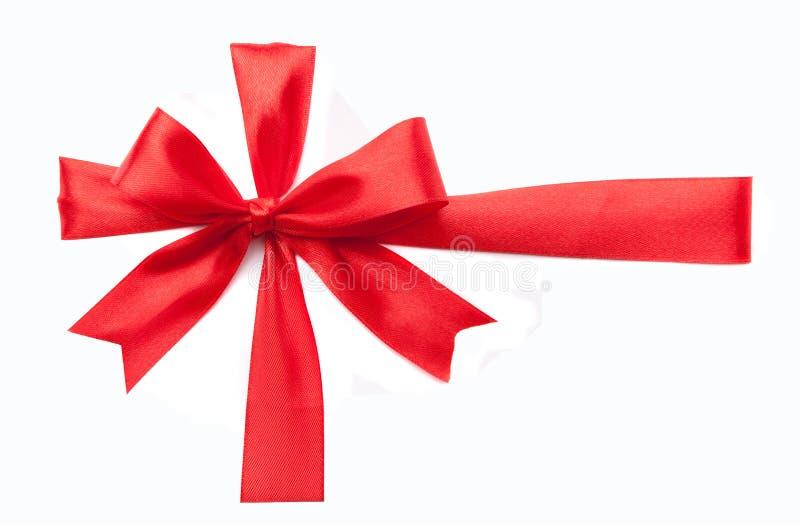 Arco rosso del regalo del nastro fotografia stock
