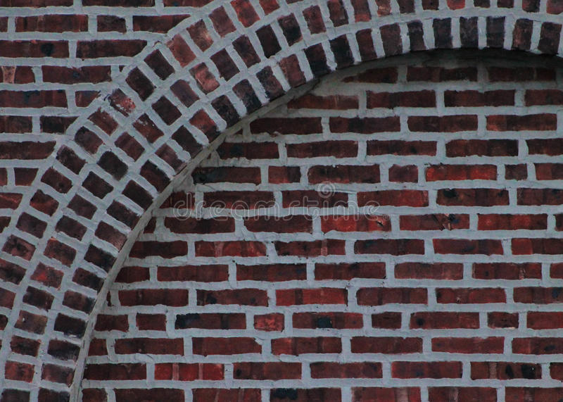 Arco y fondo del ladrillo imagen de archivo