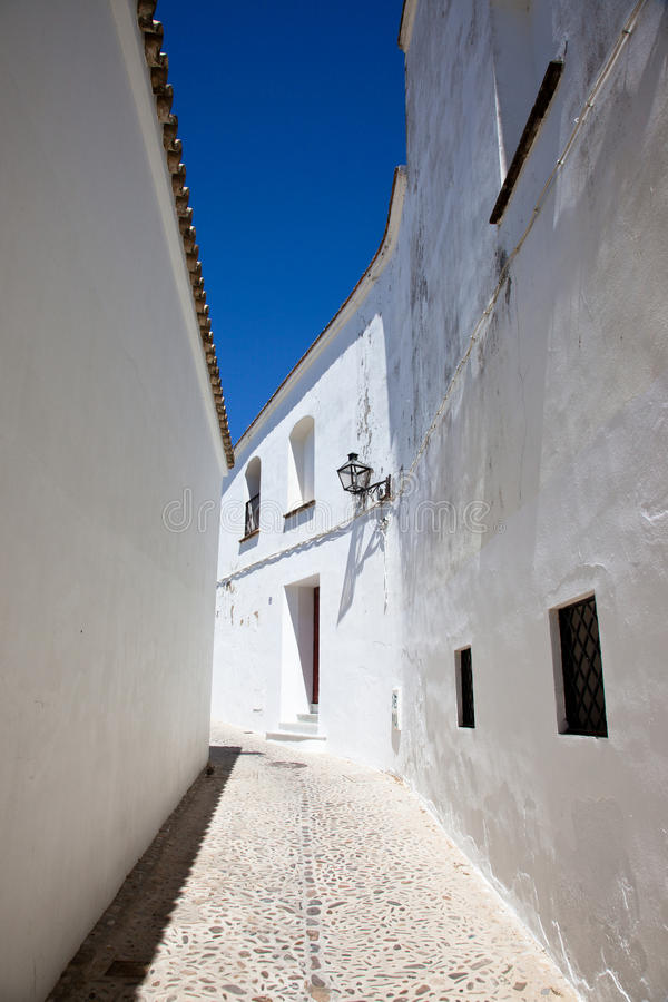 Arcos de la Frontera. Narrow white street in white village Arcos de la Frontera, Cadiz - Spain royalty free stock photo