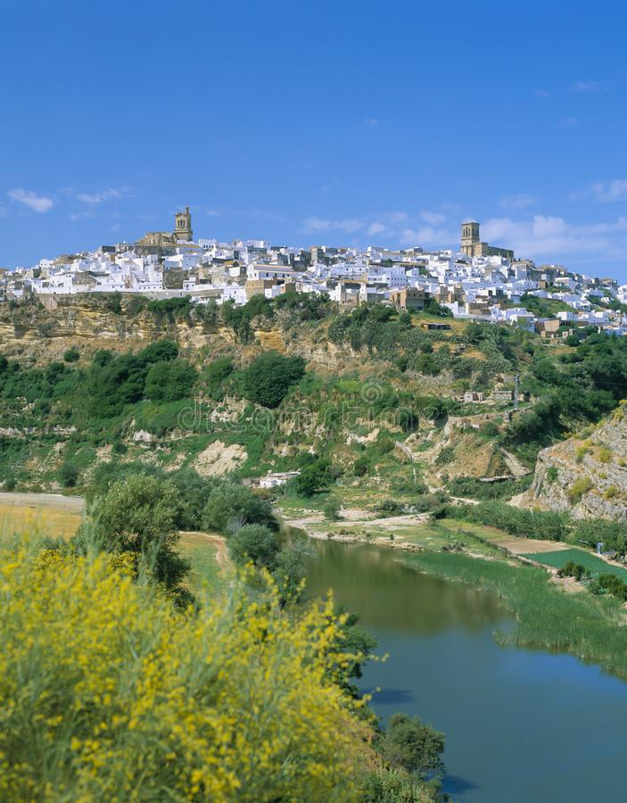 ARCOS DE LA FRONTERA,SPAIN. ARCOS DE LA FRONTERA.View over Guadalete River to clifftop town of Arcos de la Frontera . One of Andalucia`s most dramatically stock photos