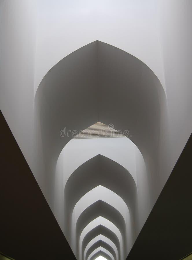 Arcos sobre o corredor longo imagem de stock royalty free