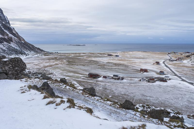 Arctic beach, farmland and village at Utakleiv, Lofoten Norway royalty free stock photography