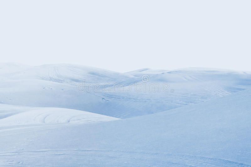 Arctic desert. winter landscape with snow drifts. Blue snow dunes on the frosty background of blue sky stock photo