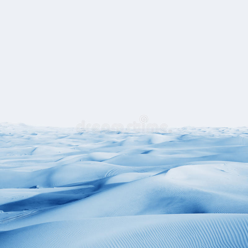 Arctic desert. winter landscape with snow drifts. Ice and snow dunes on the background of blue sky royalty free stock photo